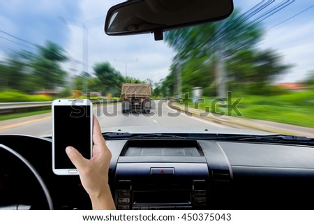 Man using cell phones while driving.
