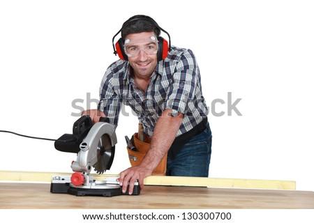 Man using circular saw - stock photo