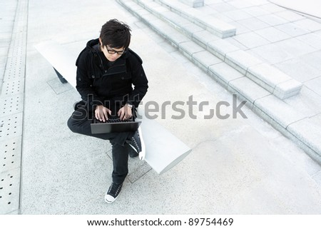 man using computer outdoor