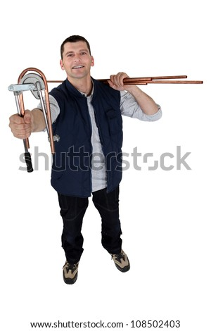 Man using copper pipe bending tool