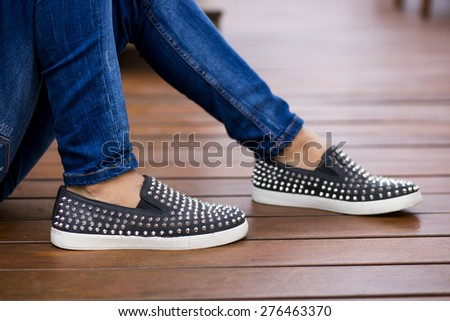 Man using flat shoes with spikes - stock photo