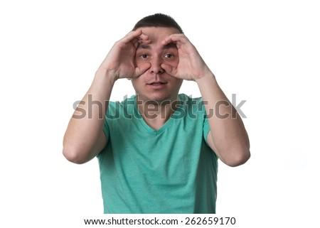 Man Using Hands Like Glasses - Isolated On White Background - stock photo