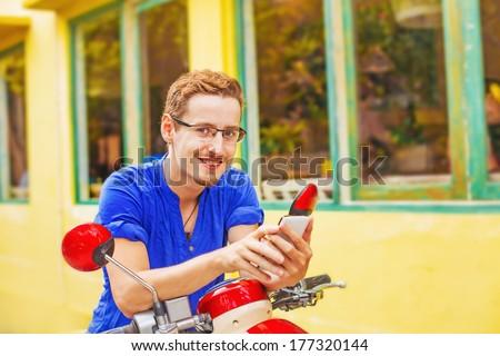 Man using his navigator on the street - stock photo