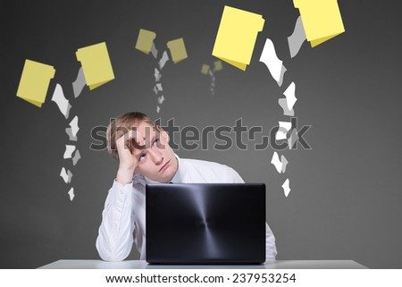 Man using laptop and icons of folders in background - stock photo