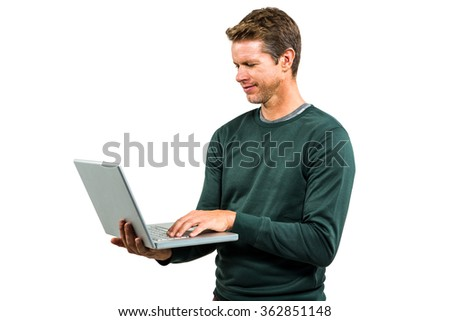 Man using laptop while standing on white background