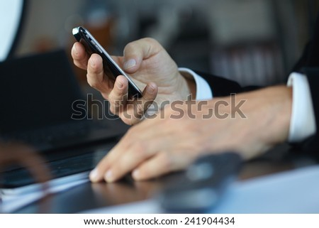 man using mobile phone - stock photo