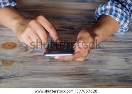 Man using mobile phone - stock photo