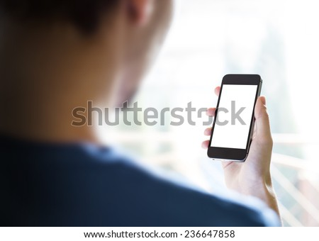 Man using mobile smartphone, iphone style. Shot with third-person view. - stock photo