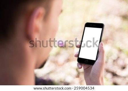 Man using mobile smartphone. Shot with third-person view, blank screen. iphon style - stock photo