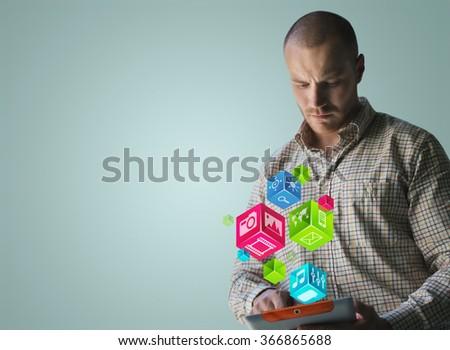 Man using modern technology on his digital device - stock photo