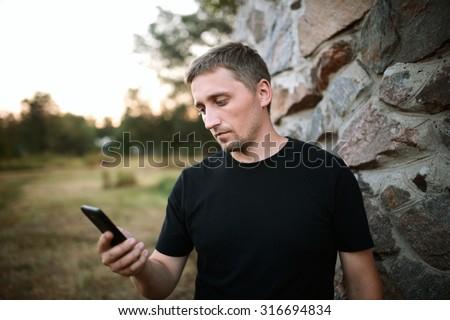 man using smart phone - stock photo