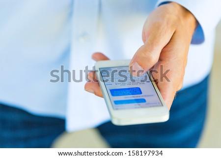 Man using smart phone, Texting - stock photo