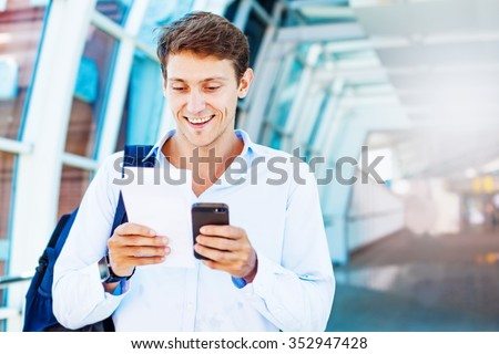 man using smart phone to book airplane tickets or do online chec kin - stock photo