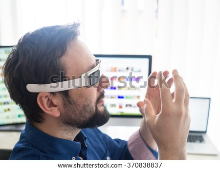 Man using smart watch as a gadget for virtual reality
