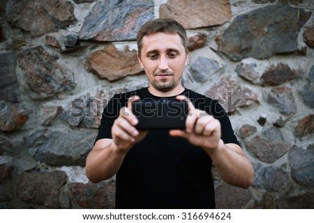 man using smartphone - stock photo