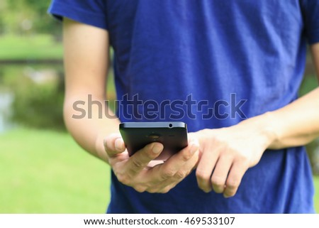 Man using smartphone. selective focus.