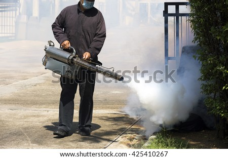 Man using smoke machine for pest control