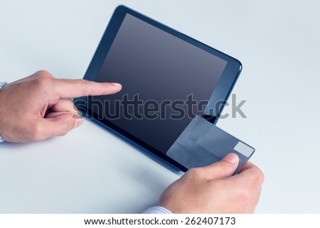 Man using tablet for online shopping in close up