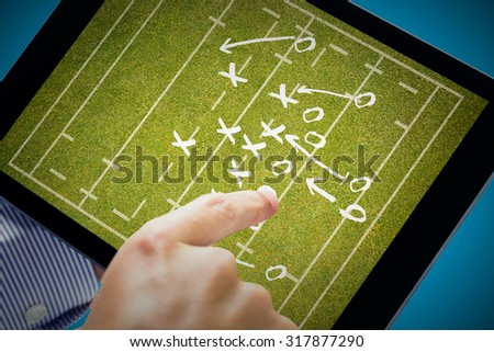 Man using tablet pc against rugby tactics