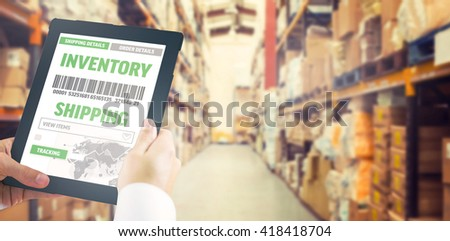 Man using tablet pc against shelves with boxes in warehouse - stock photo
