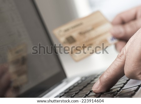 Man using tablet pc and credit card indoor, Shopping online - stock photo