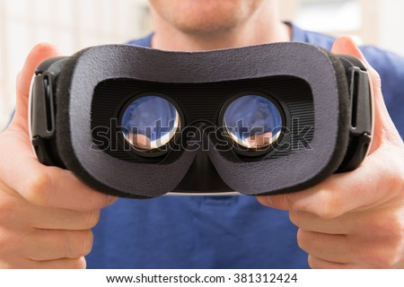Man using virtual reality headset at home