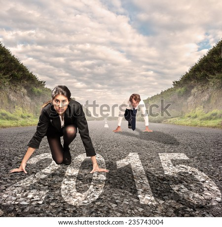 man versus woman on a road with year 2015 painted on it - stock photo