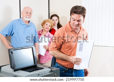 Man voting on a new touch screen machine for the first time.   - stock photo