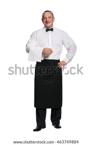 Man waiter standing aprone on isolation background. Smiling.