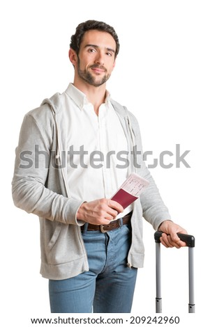 Man waiting at an airport, holding tickets, isolated in white - stock photo