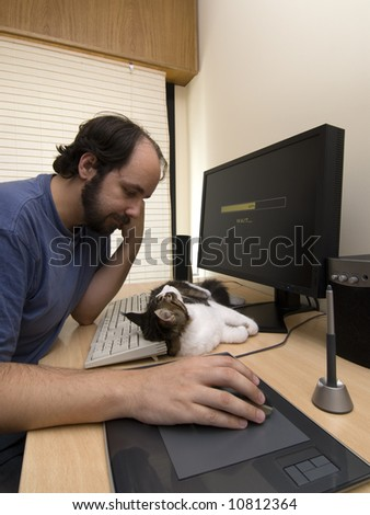 Man waiting for loading a pc application, with his cat