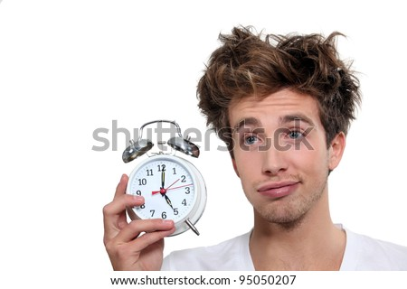 Man waking up at 5 o'clock - stock photo