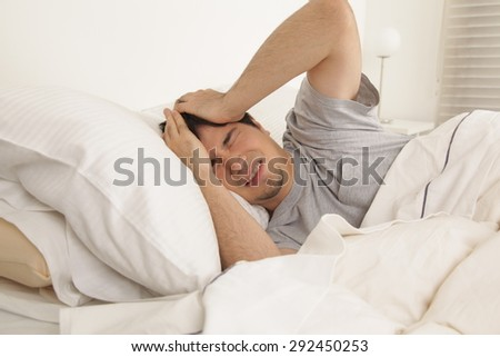 Man waking up with headache