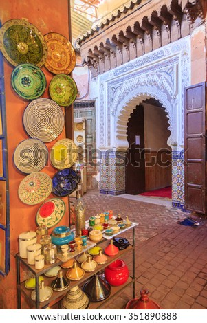 Man walk in a entrance close to a market in  Marrakech, Morocco - stock photo