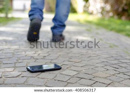 Man walking after losing his smart-phone