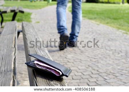 Man walking after losing his wallet - stock photo