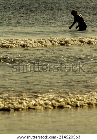 Man walking along the seashore
