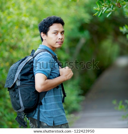 Man walking forest - stock photo