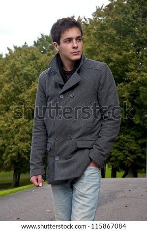 man walking in park and looking away