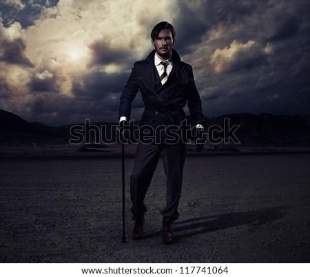 Man walking in the desert - stock photo