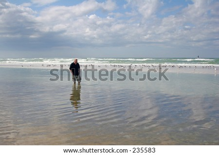 Man walking in the ocean