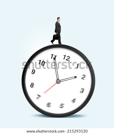 man walking on clock on a blue background - stock photo