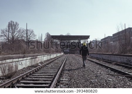 man walking on rails at olympic trains station
