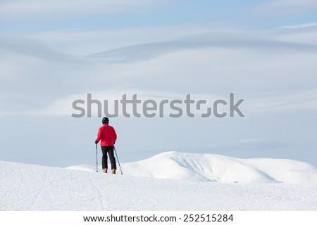 Man walking on ski in mountain - stock photo