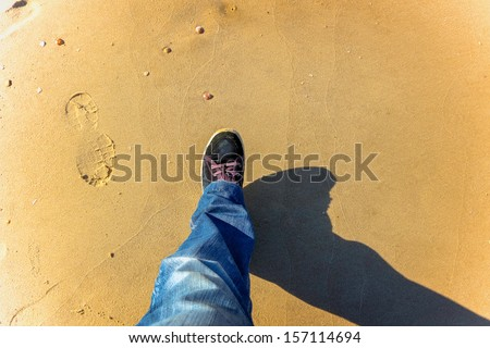 man walking on the beach - stock photo