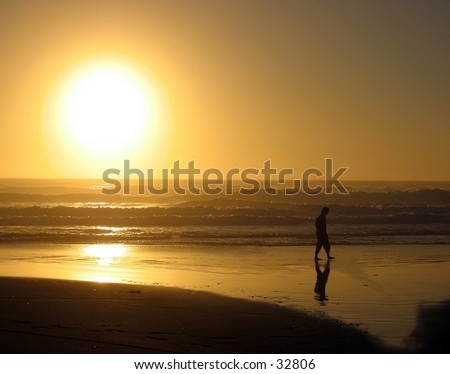 Man walking on the beach at Prairie Creek State Park, California