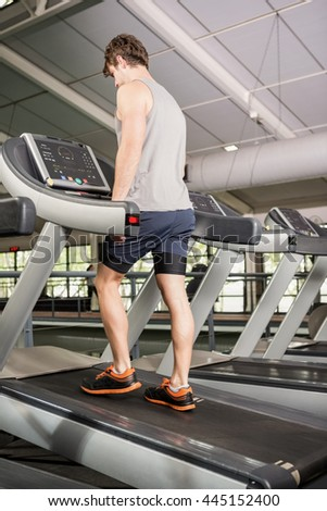 Man walking on thread mill at gym