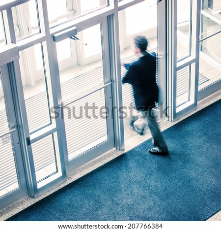 Man walking out of a business office - stock photo