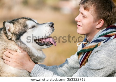 man walking with a dog Husky - stock photo