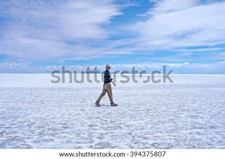 Man walks at Salar de Uyuni in Bolivia